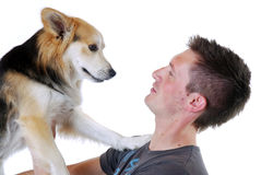 Homem novo com cão Imagem de Stock