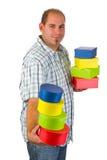 Homem novo com caixas de presente Imagens de Stock Royalty Free