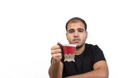 Homem novo com chávena de café imagens de stock royalty free
