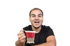Homem novo com chávena de café fotografia de stock royalty free