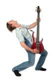 Homem novo com dança da guitarra Fotografia de Stock Royalty Free