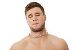 Homem novo com dor da garganta Foto de Stock