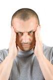 Homem novo com dor de cabeça Foto de Stock Royalty Free
