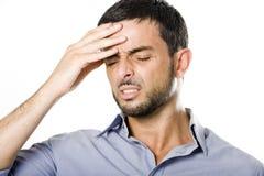 Homem novo com dor de cabeça de sofrimento da barba imagem de stock