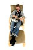 Homem novo com espetáculos, tempo de relaxamento Fotografia de Stock Royalty Free