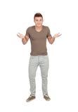 Homem novo com expressão duvidosa Imagens de Stock