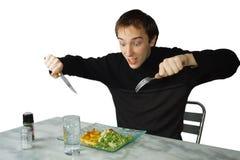 Homem novo com fome pronto para comer Foto de Stock Royalty Free