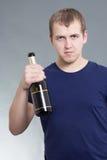 Homem novo com a garrafa do champanhe Fotos de Stock