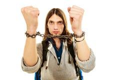 Homem novo com mãos acorrentadas Fotografia de Stock