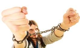 Homem novo com mãos acorrentadas Imagem de Stock