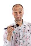 Homem novo com mãos e a face pintadas Imagens de Stock