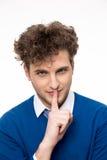Homem novo com o dedo sobre os bordos fotografia de stock royalty free
