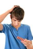 Homem novo com os comprimidos Fotografia de Stock