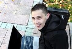 Homem novo com portátil Imagens de Stock Royalty Free