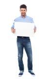 Homem novo com poster em branco Fotos de Stock