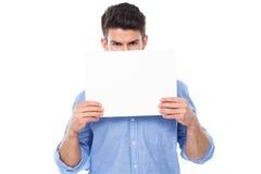 Homem novo com poster em branco Imagem de Stock