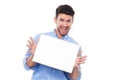 Homem novo com poster em branco Fotografia de Stock