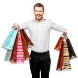 Homem novo com sacos de compra fotografia de stock royalty free