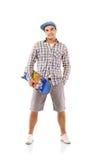 Homem novo com skate Imagens de Stock