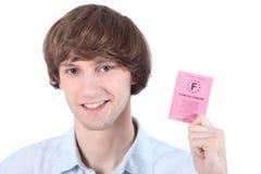 Homem com sua carta de condução Fotografia de Stock