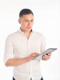 Homem novo com tabuleta Fotografia de Stock
