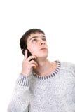 Homem novo com telefone Fotografia de Stock