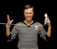 Homem novo com telefone Fotos de Stock Royalty Free