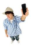 Homem novo com telefone de pilha Fotografia de Stock Royalty Free