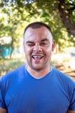 Homem novo com um dente lascado imagem de stock royalty free