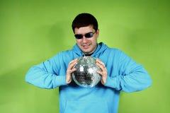 Homem novo com um discoball Imagem de Stock Royalty Free