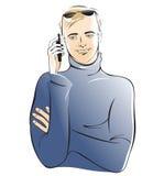 Homem novo com um telefone móvel Foto de Stock Royalty Free