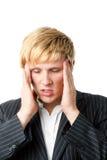Homem novo com uma dor de cabeça Fotografia de Stock Royalty Free