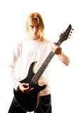 Homem novo com uma guitarra imagens de stock royalty free
