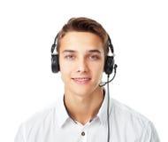 Homem novo com uns auriculares Imagens de Stock