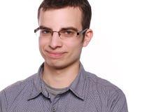 Homem novo com vidros no branco Imagens de Stock