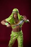 Homem novo considerável que levanta com o sabre no estúdio Fotos de Stock Royalty Free