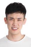 Homem novo considerável de Ásia - isolado sobre um fundo branco Fotografia de Stock