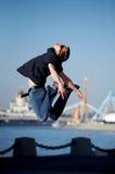 Homem novo de salto engraçado Fotografia de Stock Royalty Free