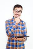 Homem novo de sorriso com uma tabuleta Fotografia de Stock