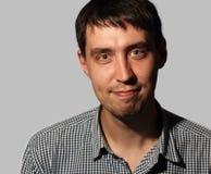 Homem novo de sorriso engraçado Imagem de Stock Royalty Free