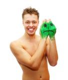 Homem novo de sorriso feliz com pintura triste da máscara do sorriso Imagem de Stock Royalty Free