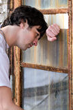 Homem novo deprimido Fotos de Stock Royalty Free
