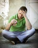 Homem novo deprimido Imagens de Stock