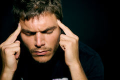 Homem novo deprimido infeliz Imagem de Stock Royalty Free