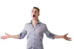 Homem novo desesperado, irritado que grita Fotografia de Stock Royalty Free