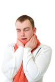 Homem novo doente que prende sua cabeça Imagem de Stock Royalty Free