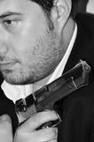 Homem novo e arma Fotos de Stock Royalty Free
