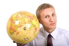 Homem novo e globus Fotos de Stock Royalty Free