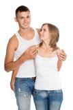Homem novo e mulher nas calças de brim Fotografia de Stock Royalty Free