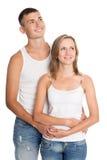 Homem novo e mulher que olham acima Imagens de Stock